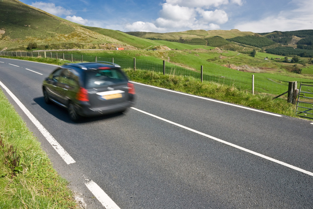 Car speeding on the mountain road in Wales